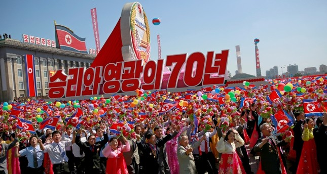 North Korean participants march with a float during a parade celebrating the National Day and 70th anniversary of its Foundation in Pyongyang, North Korea, Sept. 09, 2018. (EPA Photo)