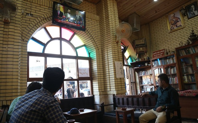 Kurdish people at a popular cafe in Irbil watch the press conference where the results of the KRG independence referendum are announced, Sept. 27.