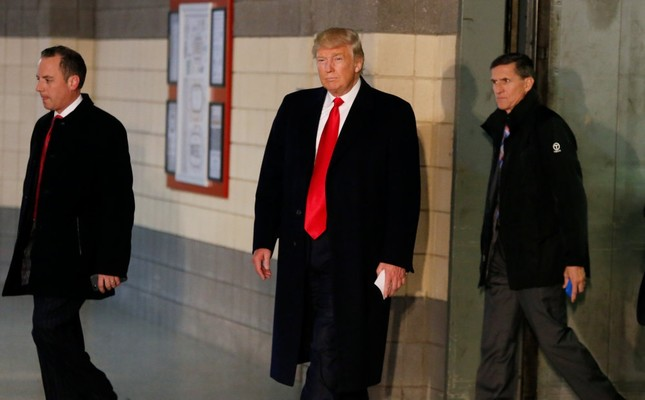 The U.S. President-elect Donald Trump and retired U.S. Army Lt. Gen. Michael Flynn (R). Flynn is on Gülentist figures' target due to his negative-view on Fetullah Gülen.