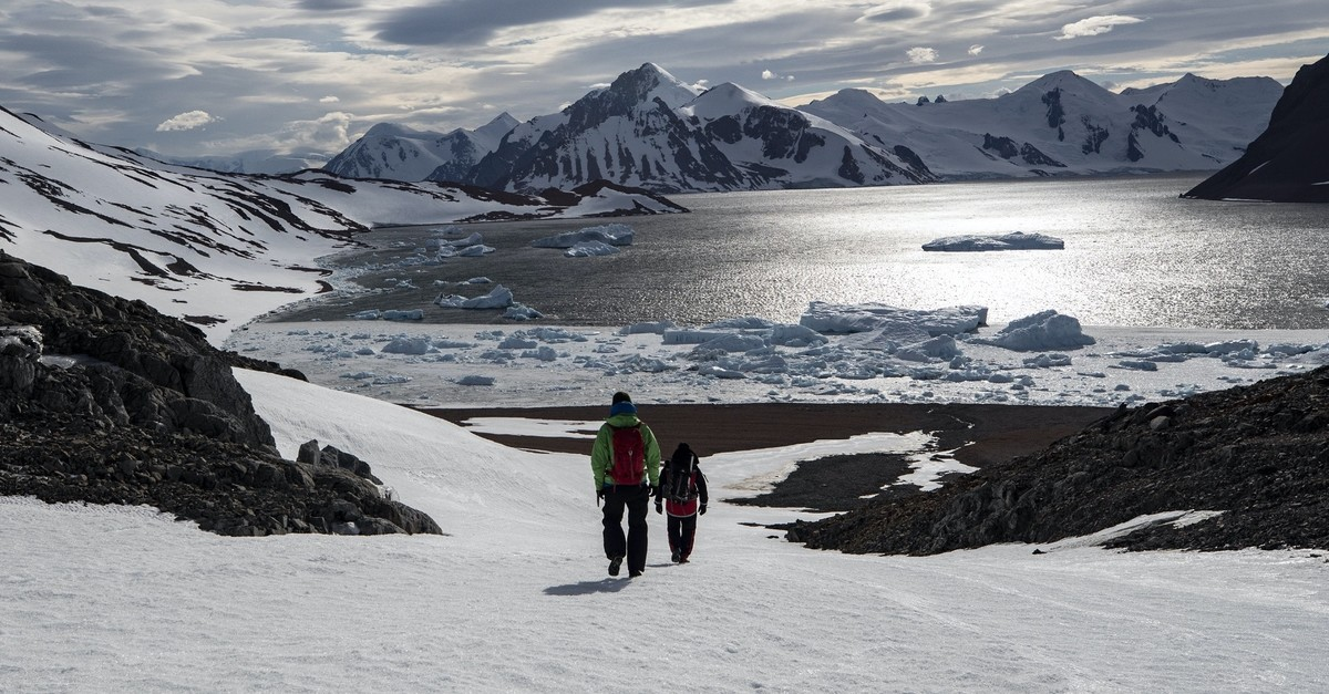 Bulgarian scientist Stefan Velev (L) and Professor Sedat Seru00e7e take a trek to collect samples on Horseshoe Island.