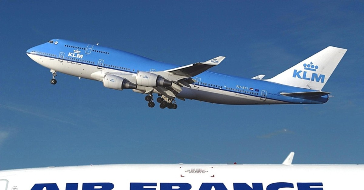 File photo taken Juanary 1, 2003 at Schipol airport in Amsterdam shows a KLM Boeing 747-400 flying over an Air-France plane (AFP Photo)