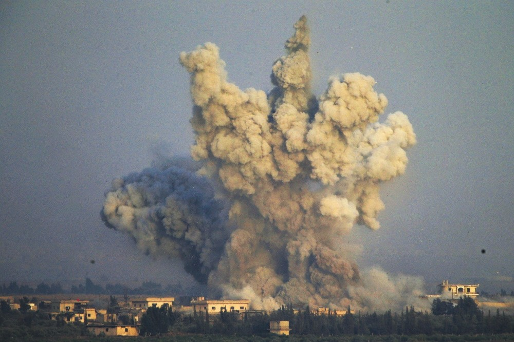 Smoke and explosions from the fighting between Assad regime forces and opposition groups, southern Syria.