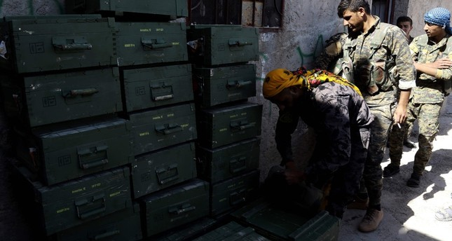 YPG terrorists unload boxes of ammunition supplied by the U.S.-led coalition, Raqqa, June 7, 2019.