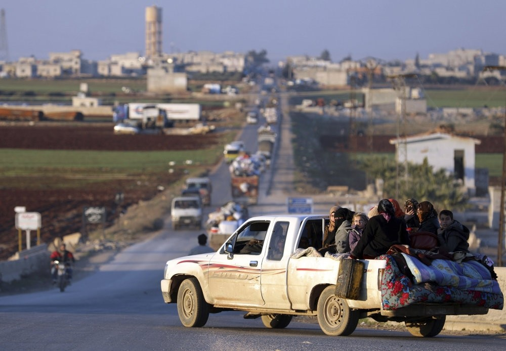 Displaced Syrians who fled the fighting in Idlib's southeastern town of Sinjar drive on a road in a rebel-held area near the city of Saraqib, Jan. 7.