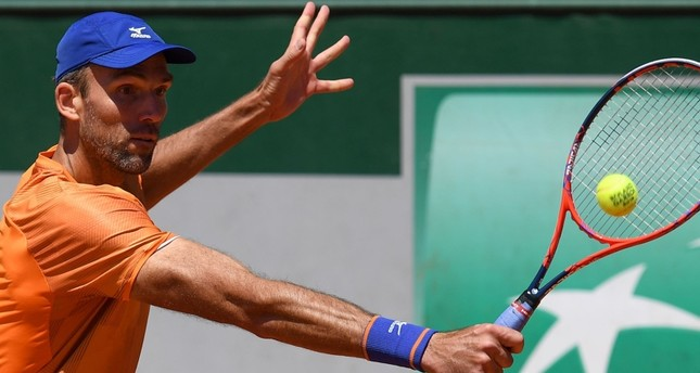 Croatia's Karlovic becomes oldest man to win match at Roland Garros for 46 years