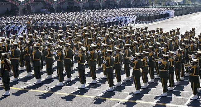 Iranian armed forces members march in a military parade marking the 37th anniversary of Iraq's 1980 invasion of Iran, in front of the shrine of the late revolutionary founder, Ayatollah Khomeini, just outside Tehran, Iran, Sept. 22, 2017. (AP Photo)