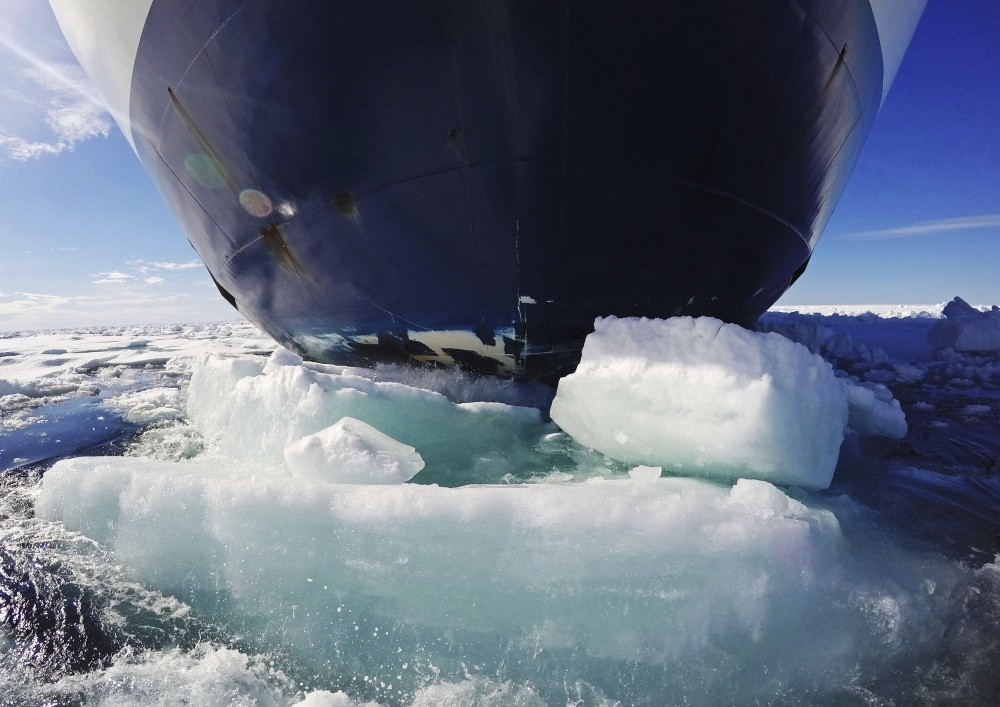 The bow of the Finnish icebreaker MSV Nordica pushes down sea ice as it traverses the Arctic's Northwest Passage through the Canadian Arctic Archipelago.