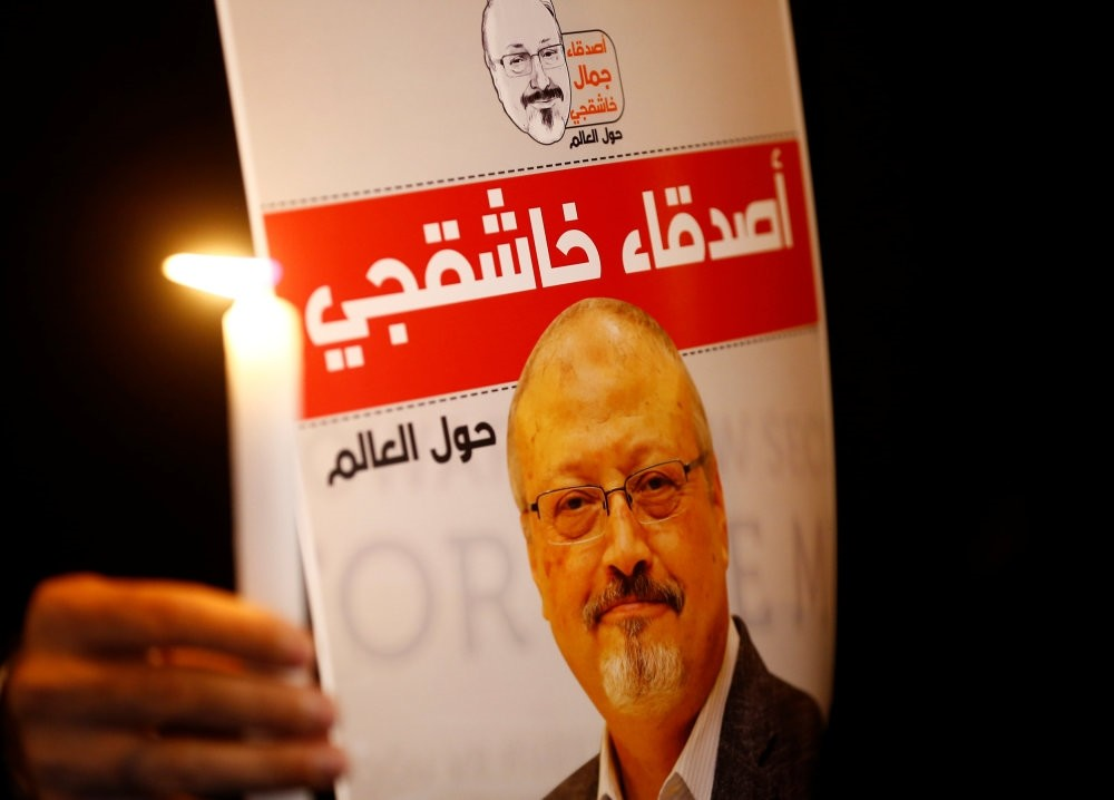 A demonstrator holds a poster with a picture of Saudi journalist Jamal Khashoggi outside the Saudi Consulate in Istanbul, Oct. 25.