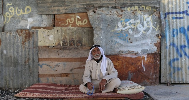 An elderly Palestinian man sits at his house in the southern Gaza Strip, Oct. 11.