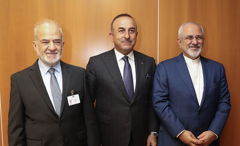 Foreign Minister Mevlu00fct u00c7avuu015fou011flu (Center) with Iraqi and Iranian counterparts in New York (AA Photo)