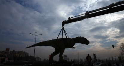 pRegarded as a symbol of unnecessary expenditure for the capital of Ankara, a giant Tyrannosaurus rex statue on the side of a busy road was removed on Monday under the orders of the city's new...