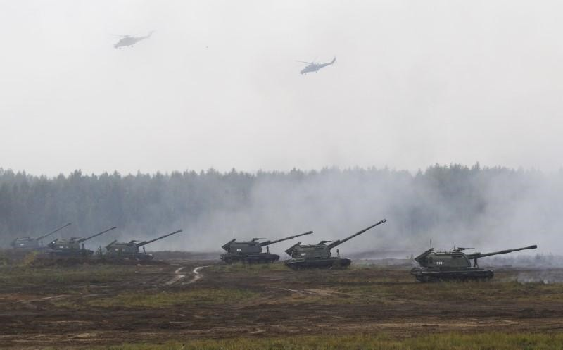 Armoured vehicles and helicopters take part in the Zapad 2017 war games at a range near the town of Borisov, Belarus September 20, 2017. (Reuters Photo)