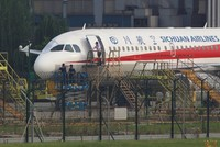 Sichuan Airlines co-pilot 'sucked halfway' out of aircraft after cockpit windscreen breaks