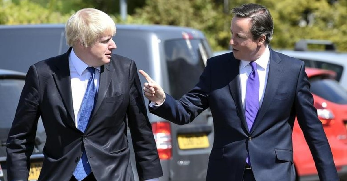 Britain's Prime Minister David Cameron (R) and London Mayor Boris Johnson arrive at the Advantage children's daycare nursery in Surbiton in south west London, April 22, 2015. (REUTERS Photo)