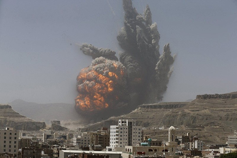 Smoke rises during an air strike on an army weapons depot on a mountain overlooking Yemen's capital Sanaa, April 20, 2015. (Reuters Photo)