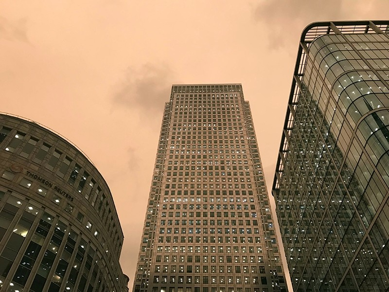 Skies over London's financial centre Canary Wharf are given a yellow glow as dust from the Sahara desert and wild fires in Spain, blown across the city by Storm Ophelia, filters out the light, in London, Britain October 16, 2017.