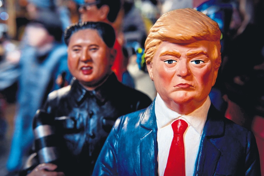 Statuettes of U.S. President Trump and North Korean leader Kim Jong Un holding a missile, in a shop, Naples, Italy, Dec. 14.