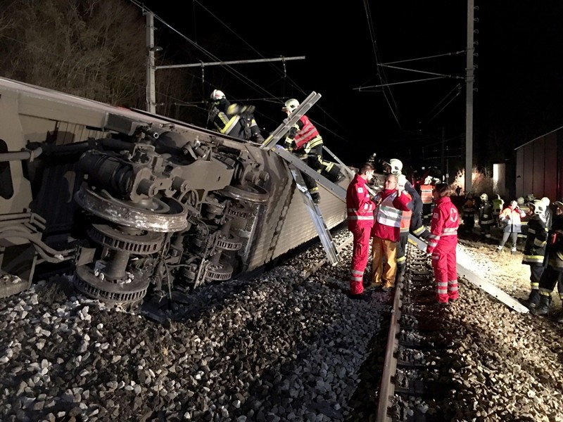 This photo shows members of the emergency services working at the scene when two passenger trains collided causing several carriages to derail in Kritzendorf, Lower Austria (AFP Photo)