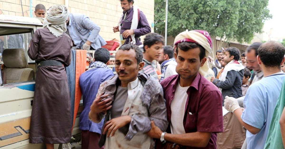 A man injured by an air strike on a market in Yemen's Saada province arrives to receive medical attention at a local Al Jomhouri hospital in Saada, Yemen July 29, 2019 (Reuters Photo)