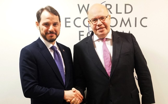 Treasury and Finance Minister Berat Albayrak (L) and Germany's Economy and Energy Minister Peter Altmaier met on the sidelines of the 49th World Economic Forum (WEF) in Davos, Switzerland, Jan. 24, 2019.