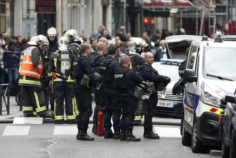French police officers stand guard at a security perimeter as a hostage taking is underway in Rue des Petites Ecuries, in Paris, France, 12 June 2018. (EPA Photo)