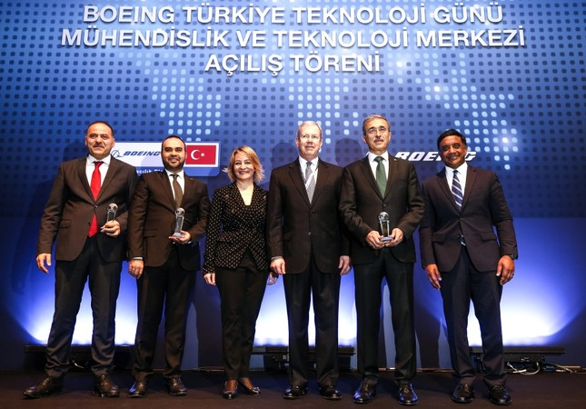 SSB Pres. Demir (2-R), Industry & Tech D. Min. Kacır (2-L), Transportation and Infrastructure D. Min. Sayan (L), BR&T's Hussain (R), Boeing Turkey's Sargın (3-L) attend the opening ceremony of Boeing's first Engineering and Technology Center, Monday.