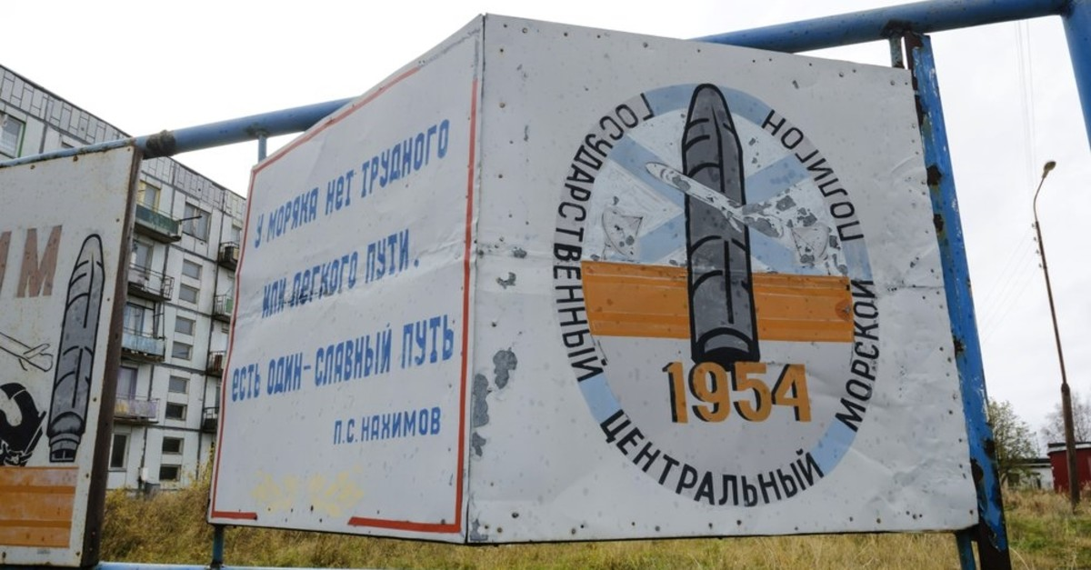 This photo taken on Oct. 7, 2018, shows a billboard that reads ,The State Central Navy Testing Range, near residential buildings in the village of Nyonoksa, northwestern Russia. (AP Photo)