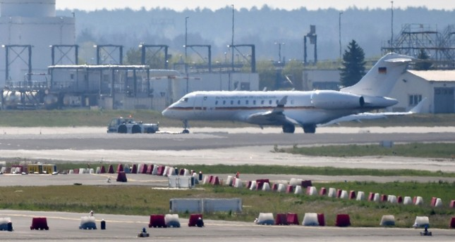 A Bombardier Global 5000 jet is being pulled over the tarmac by a truck at the airport Schoenefeld near Berlin, Germany, Tuesday, April 16, 2019. (Paul Zinken/dpa via AP)