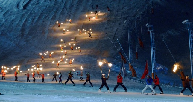 Skiers put on a show with torches in their hands during the season opening of the Palandöken Ski Resort.