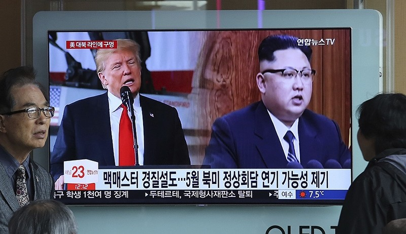 A TV screen shows North Korean leader Kim Jong Un, right, and U.S. President Donald Trump during a news program at the Seoul Railway Station in Seoul, South Korea, Saturday, March 17, 2018. (AP Photo)