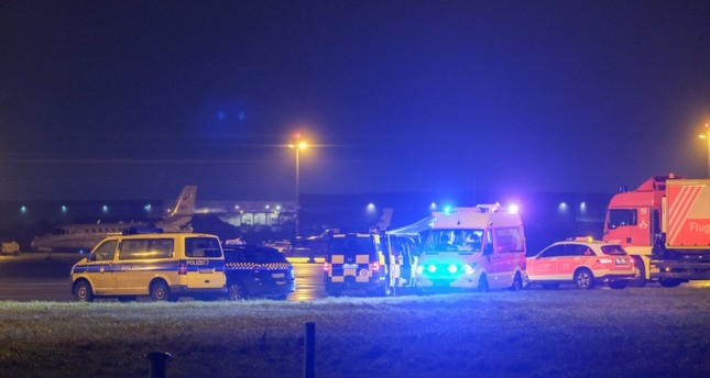 Vehicles of the emergency services are seen at the airport in Hanover on December 29, 2018  (AFP Photo)