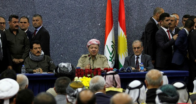 Iraqi Kurdish President Masoud Barzani sits with Kirkuk Governor Najmaldin Karim (R) during his visit in Kirkuk, Iraq September 12, 2017. (REUTERS Photo)