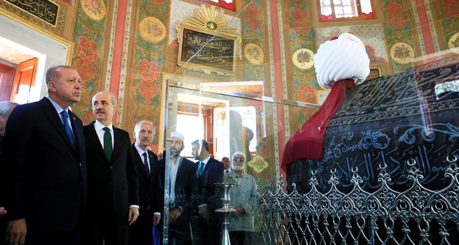 A handout photo made available by the Presidential Press Office shows President Recep Tayyip Erdoğan, left, attending an opening ceremony of Fatih Sultan Mehmed tomb at Fatih Mosque in Istanbul, Turkey, May 30, 2018.