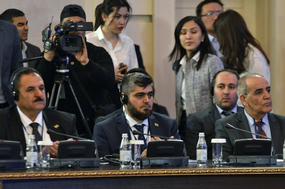 Mohammed Alloush (C), chief negotiator for the Syrian opposition, attends the second round of talks on the Syrian conflict settlement in Astana Thursday.
