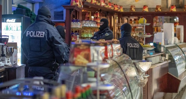 Policemen raid an ice cafe in Duisburg, western Germany, on December 5, 2018. (AFP Photo)