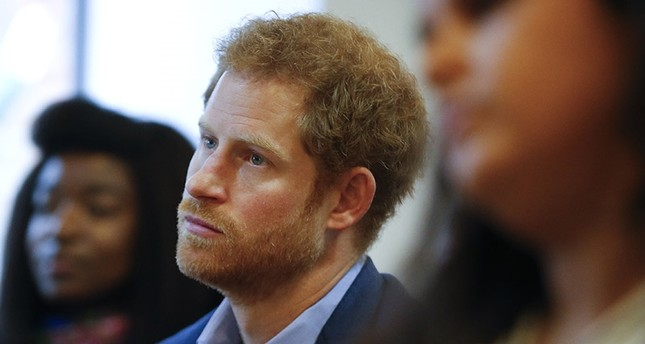 This is a  Monday, Dec. 19, 2016 file photo of Britain's Prince Harry listens to a seminar for members of staff during a visit to the Mix in London. (AP Photo)