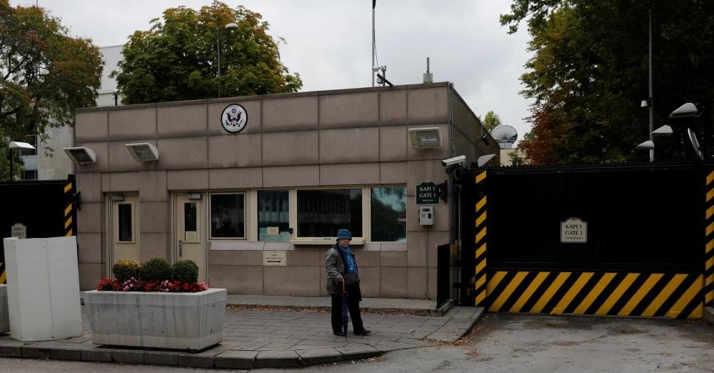 A woman walks past the U.S. Embassy, Ankara, Oct. 9.