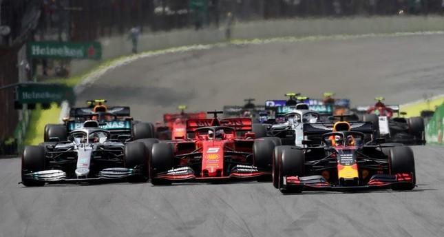 Red Bull's Max Verstappen, Ferrari's Sebastian Vettel and Mercedes' Lewis Hamilton in action at the start of the race during F1 Brazilian GP at Autodromo Jose Carlos Pace, Interlagos, Sao Paulo, Nov. 17, 2019. Reuters Photo