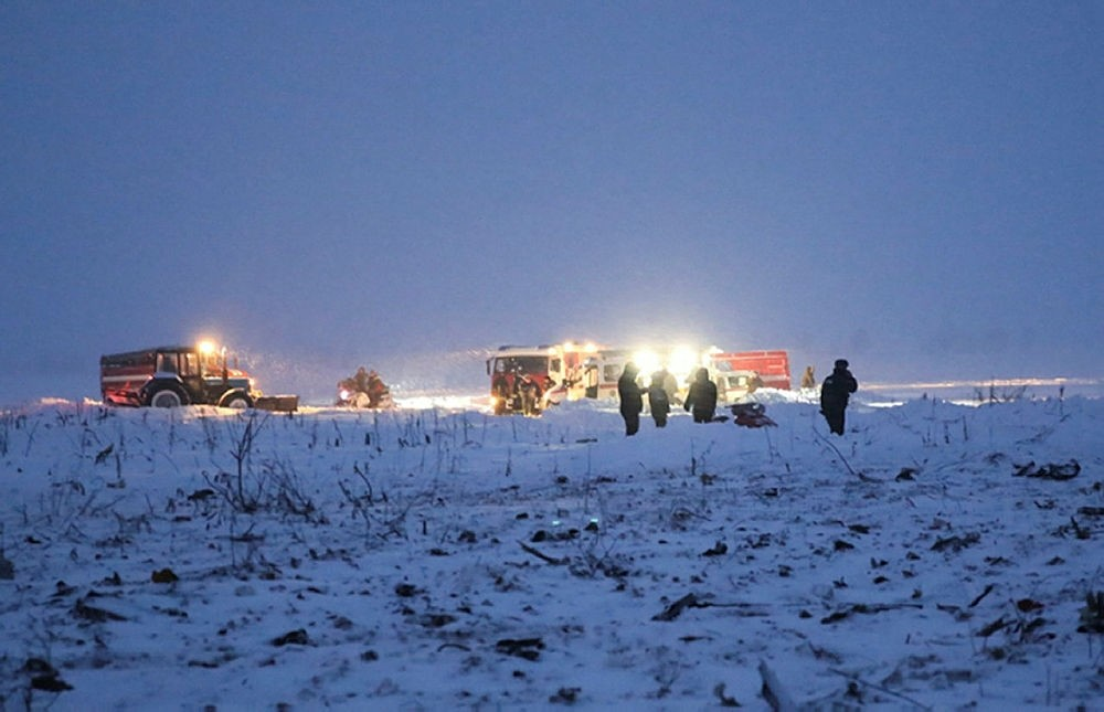 Russian Ministry for Emergency Situations employees work at the scene of a AN-148 plane crash in Stepanovskoye village, Russia, Sunday, Feb. 11, 2018. (Russian Ministry for Emergency Situations photo via AP)