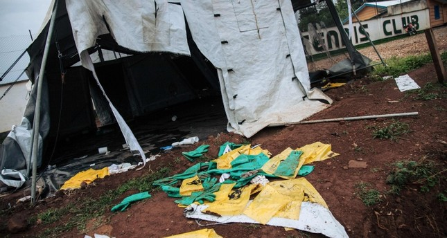 Picture taken on Dec. 27, 2018 shows protective equipment for Ebola care left on the ground next to ransacked tents by demonstrators at the Ebola transit center in Beni, following a demonstration against the postponement of elections. (AFP Photo)