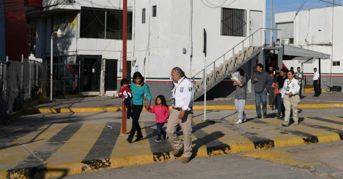 Asylum seekers are escorted by Mexican immigration officials as they are sent back to Mexico from the U.S. under the ,Remain in Mexico, program officially named Migrant Protection Protocols, in Matamoros, Tamaulipas, Mexico, Oct. 28, 2019. (Reuters)
