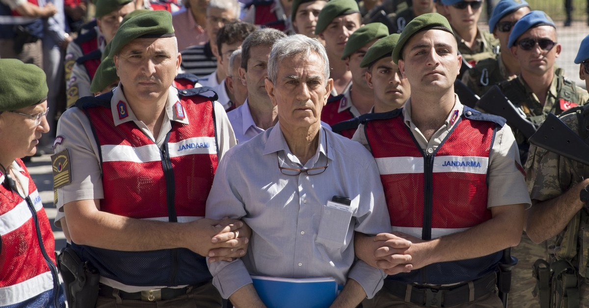 Soldiers escort Aku0131n u00d6ztu00fcrk, the former general accused of leading coup plotters, to a courtroom in Ankara, Aug. 2, 2017.