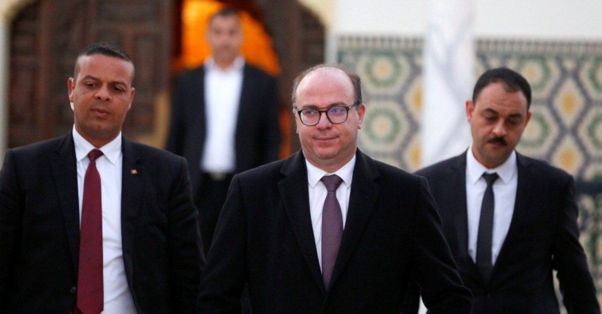 Tunisian Prime Minister Elyes Fakhfakh (C) leaves for a meeting with Tunisian President Kais Saied (not pictured) in Tunis, Tunisia February 15, 2020 (Reuters Photo)