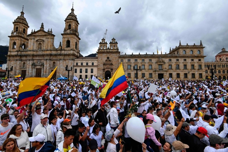 Colombians gather at Bolivar square in Bogota to demonstrate against terrorism, in repudiation of the police academy recent car bombing that left 20 people dead, and in support of the victims and their relatives, on January 20, 2019. (AFP Photo)