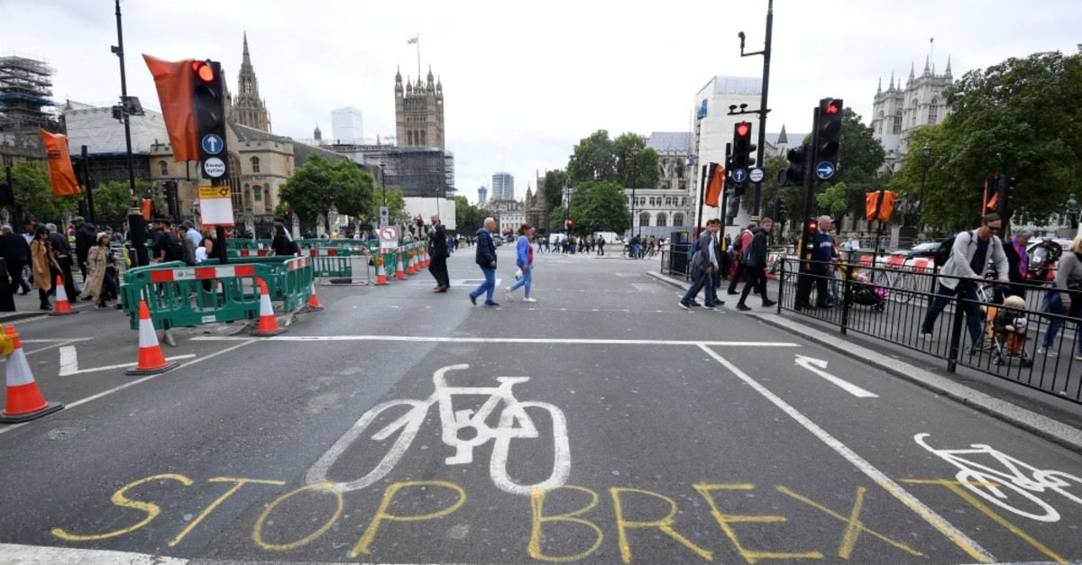 Writing on the road that reads ,Stop Brexit, seen near the Houses of Parliament, London, Sept. 11, 2019.