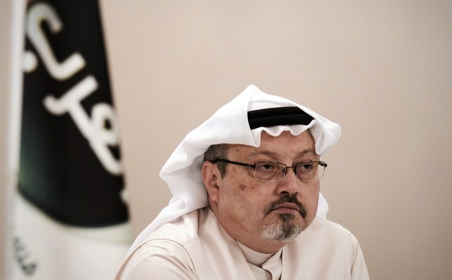 Prominent Saudi journalist and critic Jamal Khashoggi looks on during a press conference in the Bahraini capital Manama, December 2014. According to Turkish police and anonymous officials, Khashoggi was killed inside the Saudi Embassy in Istanbul aft