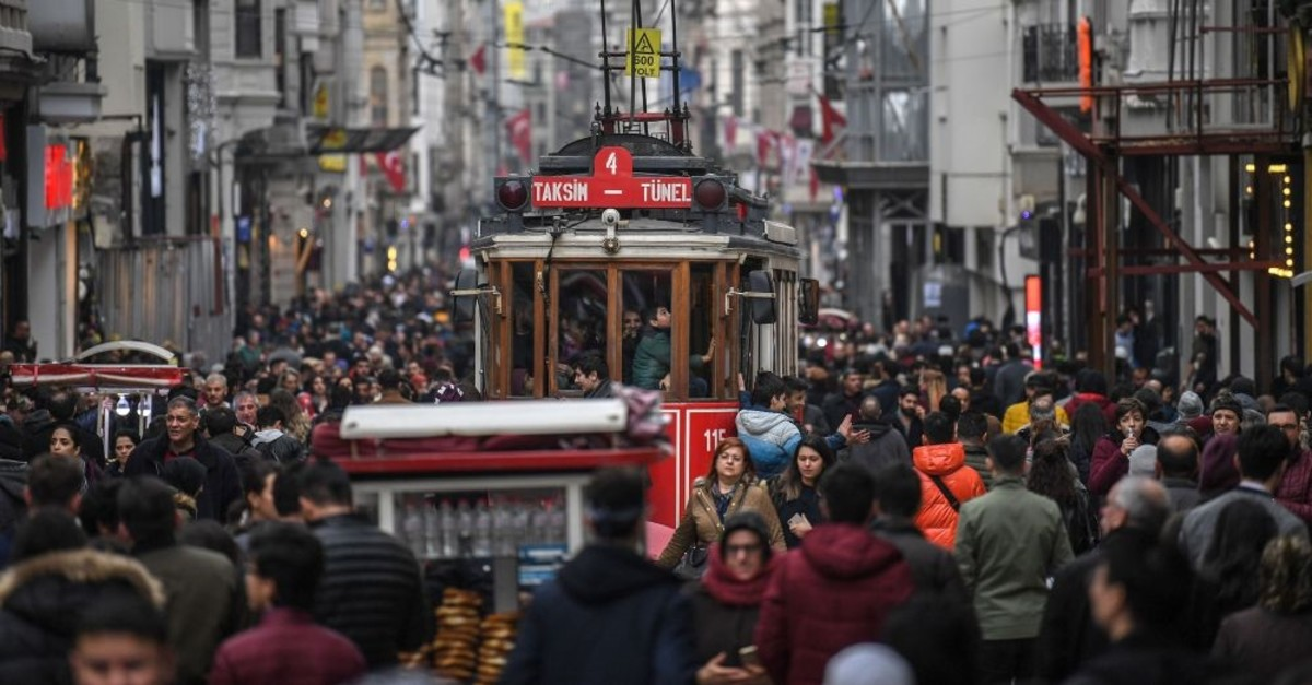 A tramway drives through a crowd in Istiklal avenue, Istanbul, Jan. 25, 2019.