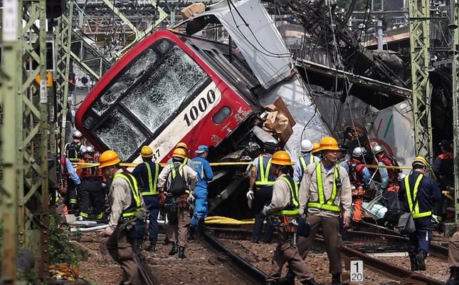 A train sits derailed after a collision with a truck in Yokohama, near Tokyo Thursday, Sept. 5, 2019. (Kyodo News via AP)
