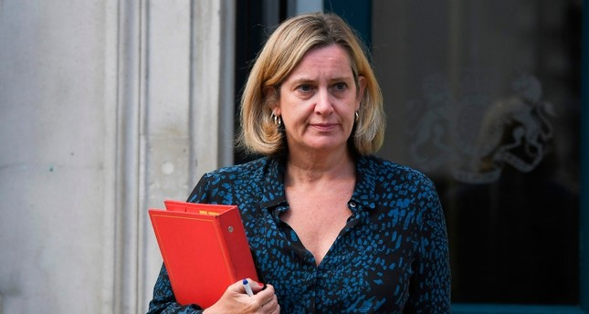 In this file photo taken on September 2, 2019 Britain's Work and Pensions Secretary and Women's minister Amber Rudd leaves the Cabinet Office on Whitehall in London (AFP Photo)