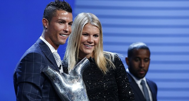 Cristiano Ronaldo of Real Madrid (L), UEFA's Best Player in Europe 2015/2016 poses with Norwegian player Ada Hegerberg of Olympique Lyon (R) UEFA's Best Women's Player in Europe 2015/2016.